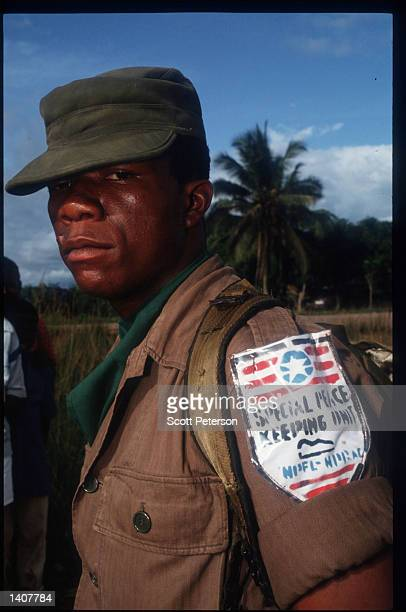A soldier stands at NPFL headquarters August 10 1992 in Gbarnga Liberia The National Patriotic Front of Liberia which rebelled against the Doe...