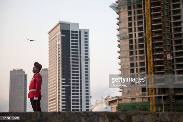 A soldier stands before a flag lowering ceremony on Galle Face Green in Colombo Sri Lanka on Saturday April 22 2017 Once fought over by European...