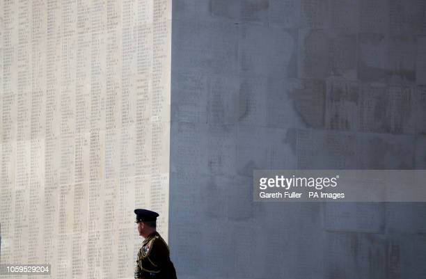 A soldier stands besides the wall of names memorialising those who have no known grave during a wreath laying ceremony at the Thiepval Memorial in...