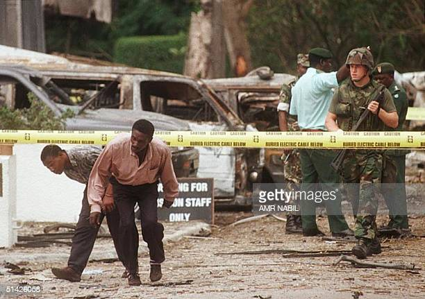 US soldier stands guard 08 August in front of the US embassy the site of the 07 August bomb blast that killed eight people 111 people were killed in...