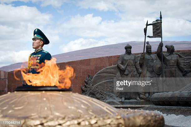 A soldier stands guard ahead of a wreathlaying ceremony by British Prime Minister David Cameron at the Monument of the Motherland Defenders on July 1...