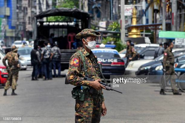 Soldier stands guard along a road as security forces search for protesters, who had been taking part in a demonstration against the military coup, in...
