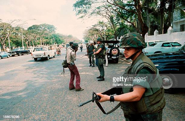 Soldier stands guard as America pulls out of Cambodia. Since early morning, secret evacuation orders have been passed around Phom Penh. Operation...