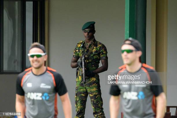 A soldier stands guard as New Zealand's cricketers take part in a practice session at P Sara Oval cricket stadium in Colombo on August 20 ahead of...