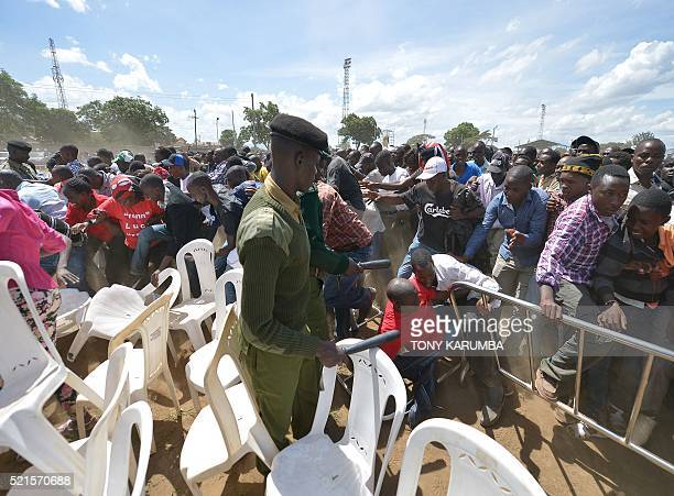 A soldier stands guard as supporters of Kenya's President Uhuru Kenyatta and of his deputy William Ruto overrun a security barricade to get closer to...