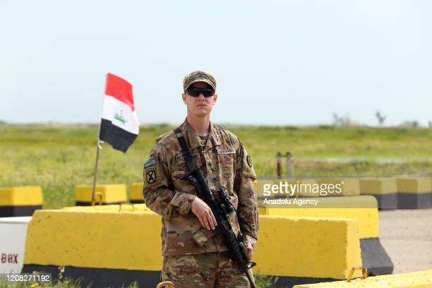 Soldier stands guard as the U.S.-led coalition against the Daesh/ISIS terror group on Thursday formally handed over to Iraq the Qayyarah airbase in...
