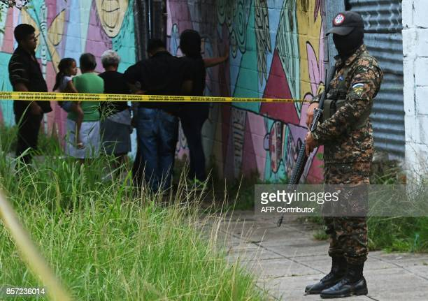 A soldier stands guard at a crime scene in San Salvador on October 2 2017 El Salvador on September suffered an increase in the number of homicides...
