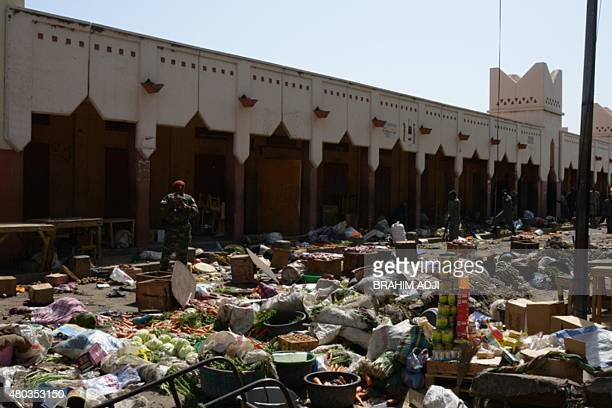 A soldier stands guard at a market in N'Djamena following a suicide bomb attack on July 11 2015 At least 14 people were killed in a suicide bomb...