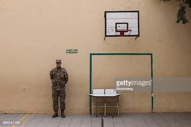 A soldier stands guard at a polling station during the presidential election in Buenos Aires Argentina on Sunday Oct 25 2015 Argentina is moving a...