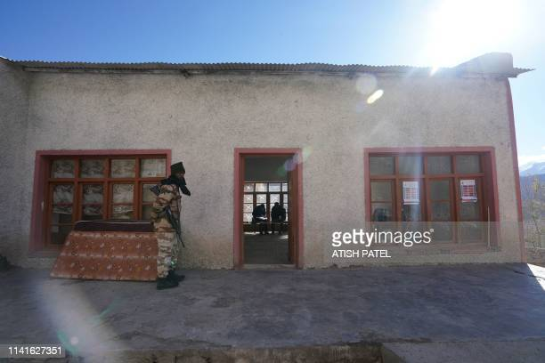 A soldier stands guard at a polling station near the Hemis Monastery about 45km from Leh in India's Ladakh region on May 6 2019 India held on May 6...