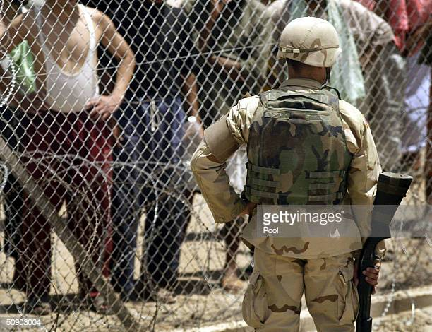 A soldier stands guard at Abu Ghraib prison May 26 2004 in Baghdad Iraq The US military to moved detainees to the newly built Camp Redemption in...