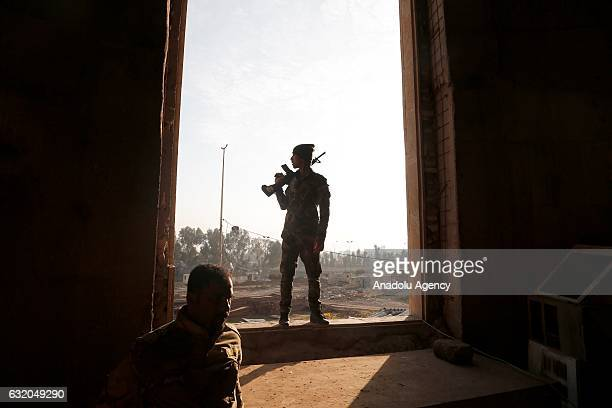 A soldier stands guard at Great Mosque of Mosul as they completely liberate eastern part of Mosul Iraq on January 18 2017 Eastern Mosul east of...