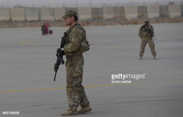 Soldier stands guard at Kandahar Air base in Afghanistan on January 23, 2018. A squadron of A-10C 'Warthog' Thunderbolt IIs deployed to this...