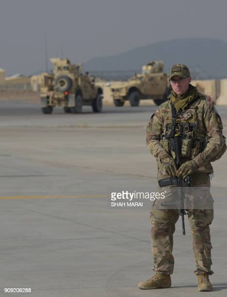 A US soldier stands guard at Kandahar Air base in Afghanistan on January 23 2018 A squadron of A10C 'Warthog' Thunderbolt IIs deployed to this...