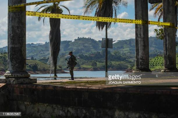 A soldier stands guard at La Manuela a former vacation estate of late drug kingpin Pablo Escobar's family on El Penol reservoir in the municipality...