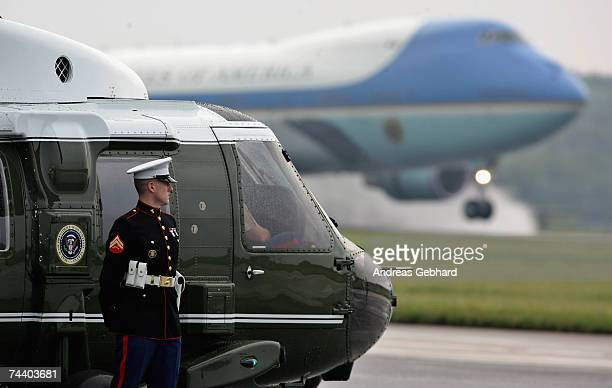 Soldier stands guard at Marine One as Air Force One, carrying US President George W. Bush, lands at the airport on June 5, 2007 in Rostock-Laage,...