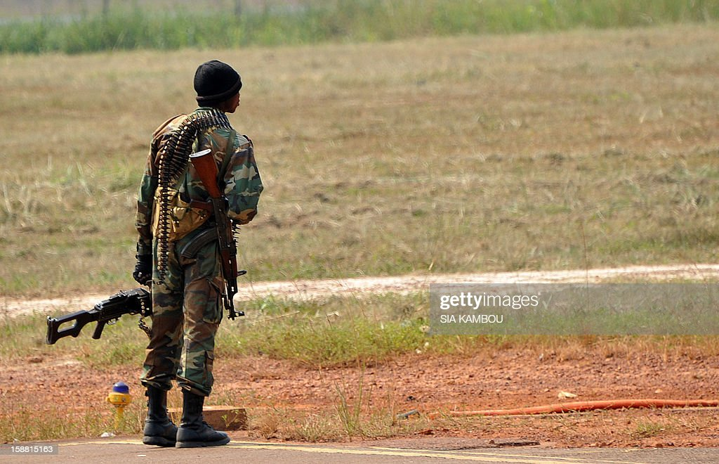 A soldier stands guard at the airport in Bangui as the President of the Central African Republic greets the current president of the African Union and President of Benin, on December 30, 2012. Rebels in the Central African Republic who have advanced towards the capital Bangui warned they could enter the city even as the head of the African Union prepared to launch peace negotiations. Central African President Francois Bozize also stated today he was open to a national unity government after talks with rebel leaders and that he would not run for president in 2016.