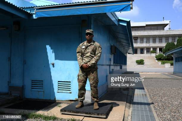 Soldier stands guard at the border village of Panmunjom between South and North Korea during a ceremony to commemorate the 66th Anniversary of the...