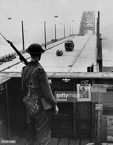 Soldier stands guard at the bridge at Nijmegen, the Netherlands, captured intact by Allied forces during Operation Market-Garden. September 21, 1944.