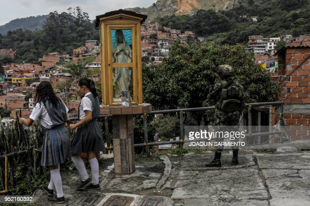TOPSHOT A soldier stands guard at the Comuna 13 neighborhood in Medellin Antioquia department Colombia on April 27 2018 The Comuna 13 neighbourhood...