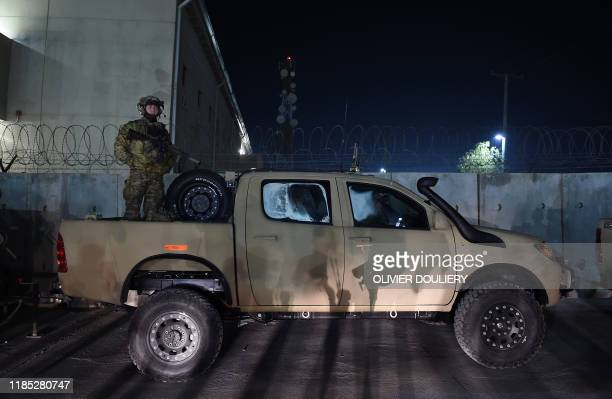 Soldier stands guard during a surprise visit of US President Donald Trump at Bagram Air Field on November 28, 2019 in Afghanistan.