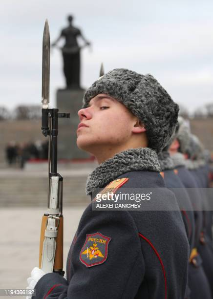 A soldier stands guard during a wreath laying commemoration ceremony for the 75th anniversary since the Leningrad siege was lifted during the World...