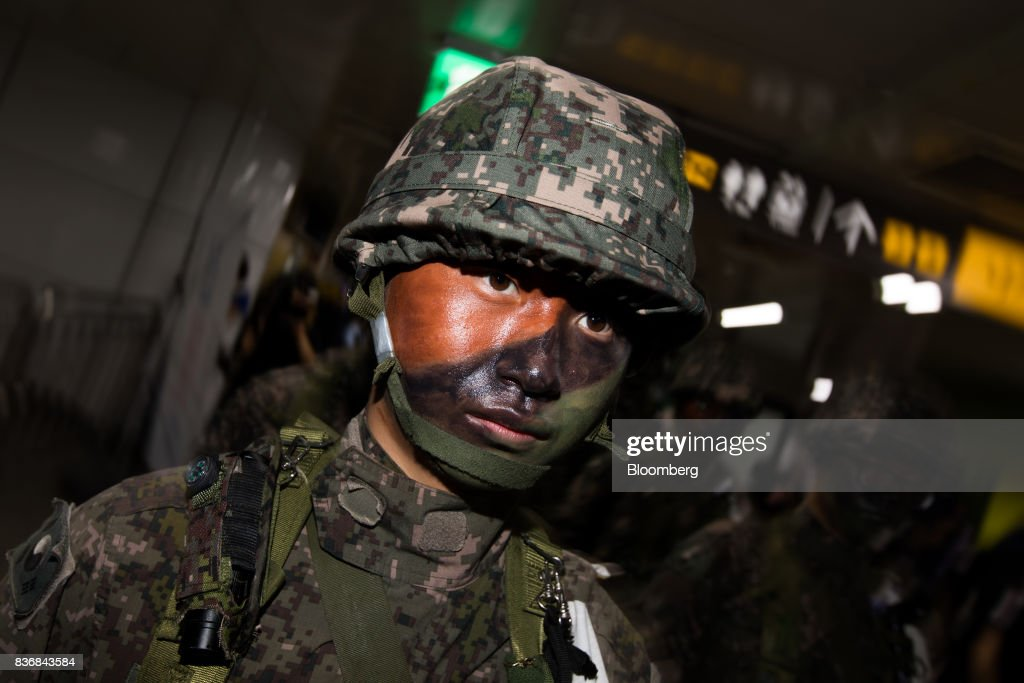 A soldier stands guard during an anti-terror drill on the sidelines of the Ulchi Freedom Guardian (UFG) military exercises at a subway station in Seoul, South Korea, on Tuesday, Aug. 22, 2017. North Korea warned the U.S. on Tuesday it will face 'merciless revenge' for ignoring Pyongyangs warnings over annual military drills with South Korea. Photographer: SeongJoon Cho/Bloomberg via Getty Images
