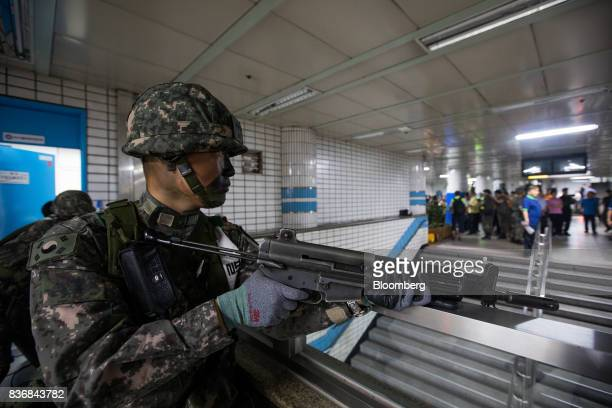 A soldier stands guard during an antiterror drill on the sidelines of the Ulchi Freedom Guardian military exercises at a subway station in Seoul...
