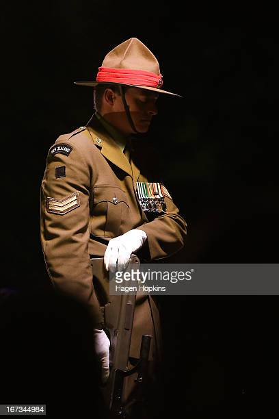 A soldier stands guard during dawn service at the Wellington cenotaph on April 25 2013 in Wellington New Zealand Veterans dignitaries and members of...