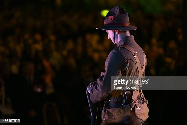 A soldier stands guard during dawn service at the Wellington Cenotaph on April 25 2014 in Wellington New Zealand Veterans dignitaries and members of...
