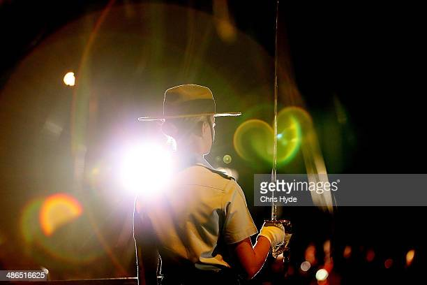 A soldier stands guard during the ANZAC dawn service at Currumbin Surf Life Saving Club on April 25 2014 in Gold Coast Australia Veterans dignitaries...