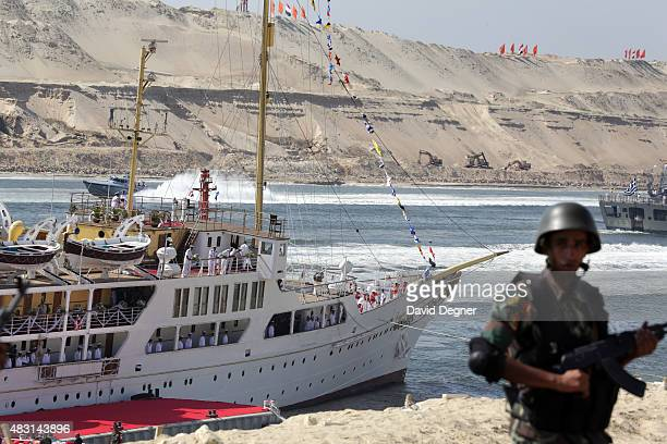 A soldier stands guard during the opening ceremony of the new Suez Canal expansion including a new 35km channel on August 6 2015 in Suez Egypt The...