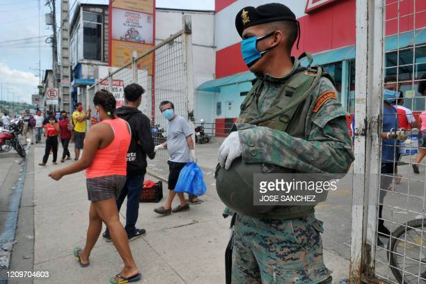 A soldier stands guard in a street of Guayaquil Ecuador on April 11 2020 Guayaquil Mayor Cynthia Viteri suggested Friday using lines of soldiers to...