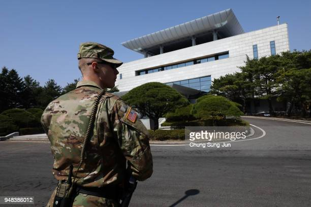 S soldier stands guard in front of the Peace House the venue of third interKorean summit at the South Koreaside of the the border village of...