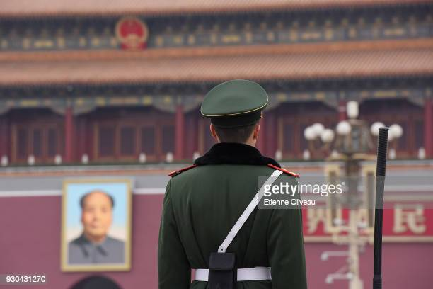 Soldier stands guard in front of Tiananmen square before the third plenary session of the first session of the 13th National People's Congress at The...
