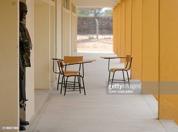 A soldier stands guard in the campus of Garissa University College on April 2 2016 in Garissa ahead of the inaugural Garissa marathon Kenyans...