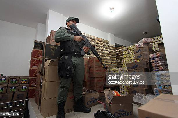 A soldier stands guard inside a supermarket in San Antonio de Tachira close to the border with Colombia on August 27 2015 Venezuelan President...