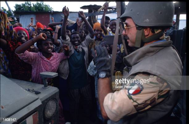 Soldier stands guard July 9, 1993 in Mogadishu, Somalia. Tension continues to escalate following the deadly skirmishes between Somali rebels and...