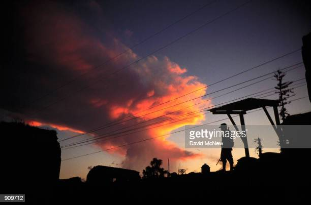 A soldier stands guard on a rooftop in the colonial city of Antigua Guatemala For three decades a civil war plagued Guatemala but received less...