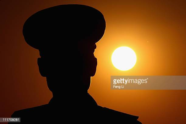 A soldier stands guard on the aircraft park of the Pyongyang Airport on April 3 2011 in Pyongyang North Korea Pyongyang is the capital city of North...