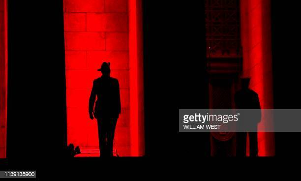 A soldier stands guard on the steps of the Shrine of Remembrance at the Anzac Day dawn service in Melbourne on April 25 2019 Dawn services were held...