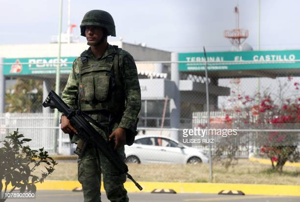 A soldier stands guard outside a Pemex storage and distribution center in El Salto Jalisco state as part of measures taken due to the shortage of...