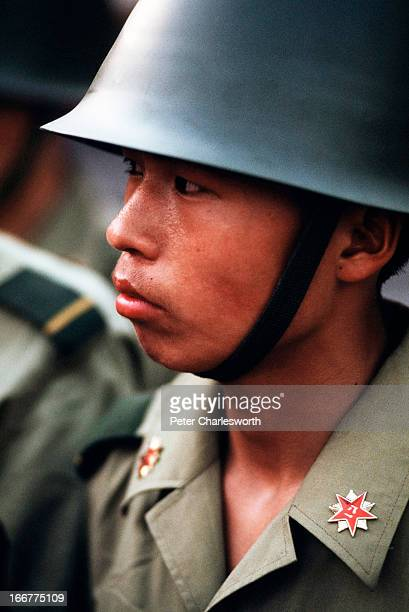 A soldier stands guard outside the Chinese Communist Party's headquarters on Chiangan Avenue to keep back prodemocracy demonstrators just days before...