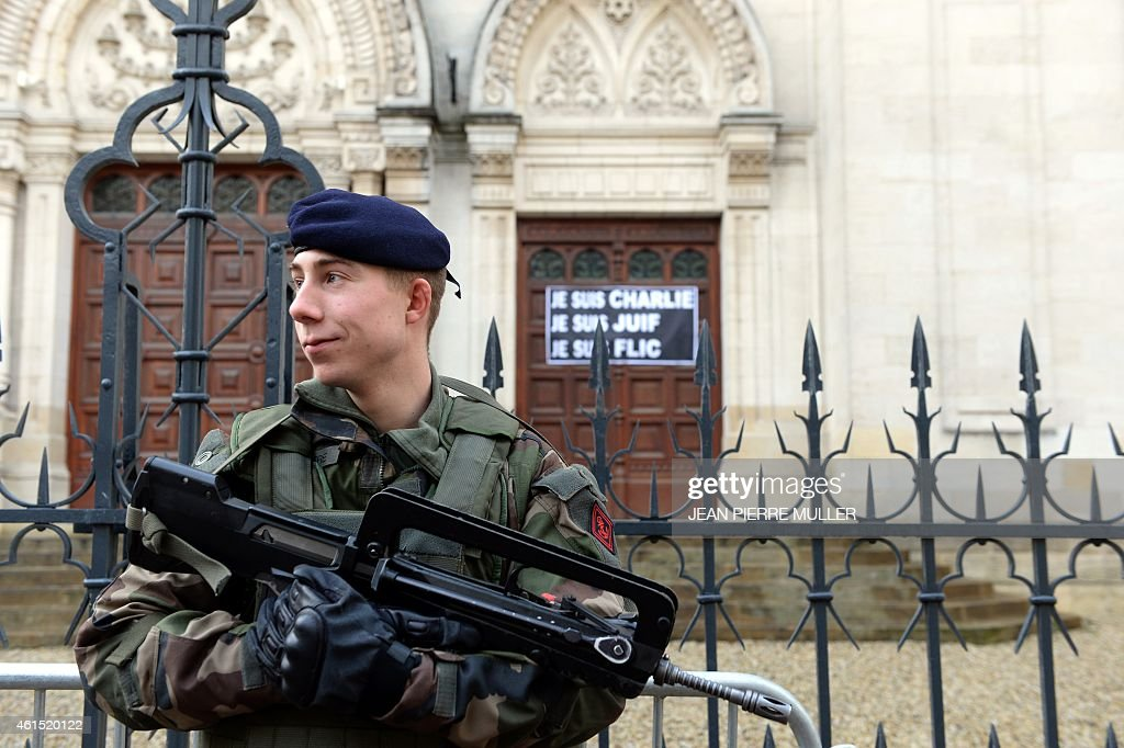 A soldier stands guard outside the main Synagogue in Bordeaux on January 14, 2015. France announced an unprecedented deployment of thousands of troops and police to bolster security at 'sensitive' sites including Jewish schools on January 12, 2015, a day after marches gathering nearly four million people countrywide.