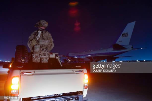 Soldier stands guards next to Air Force One as US President Donald Trump makes a surprise Thanksgiving day visit with US troops stationed at Bagram...