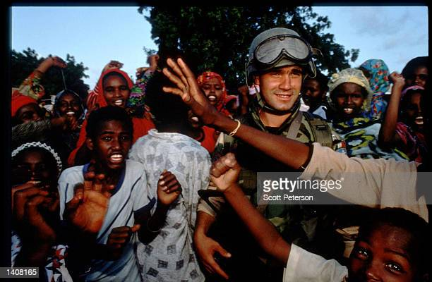 A soldier stands in a crowd July 9 1993 in Mogadishu Somalia Tension continues to escalate following the deadly skirmishes between Somali rebels and...