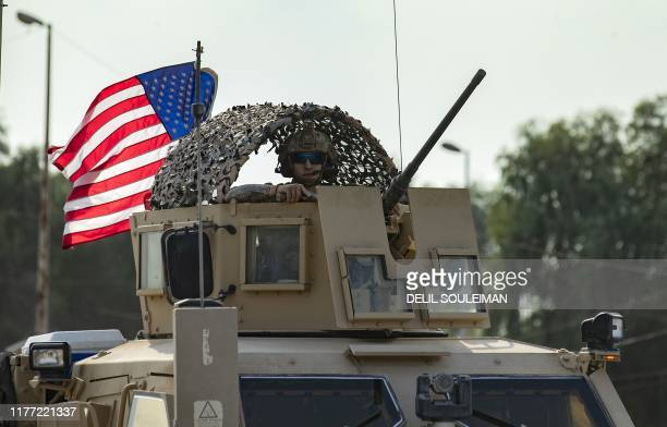 Soldier stands in an armoured personnel carrier as the US forces pull out of their base in the Northern Syrian town of Tal Tamr, on October 20, 2019....