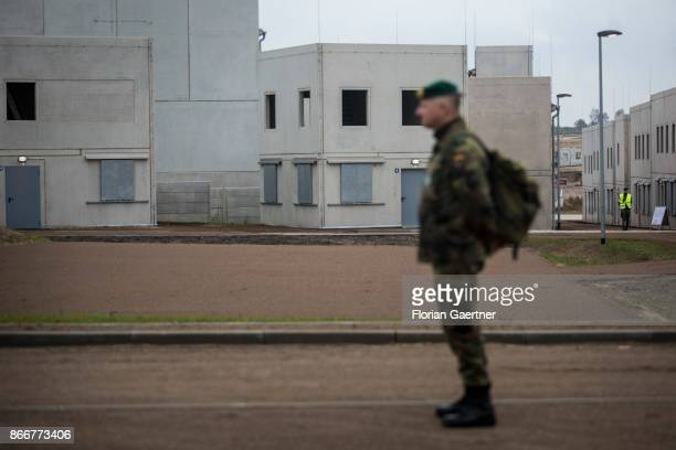 A soldier stands in front of buildings of the urban agglomeration 'Schnoeggersburg' on October 26 2017 in Schnoeggersburg Germany The urban...
