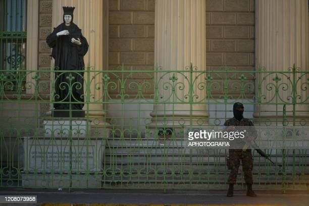 A soldier stands in front of El Salvador´s National Palace on March 23 2020 in San Salvador El Salvador Three cases of COVID19 have been confirmed in...