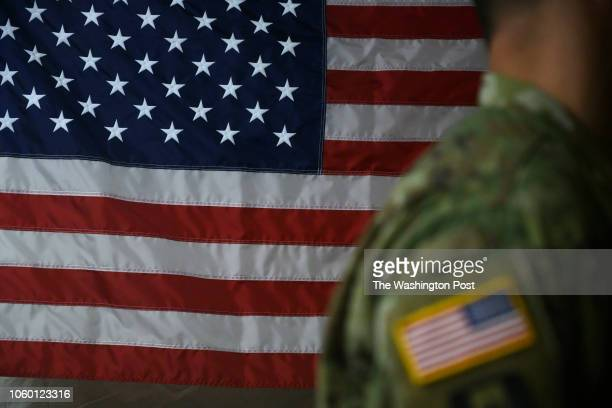 A soldier stands in front of the flag during a training session at the military base camp Donna along the Mexican border in Donna Texas on November...